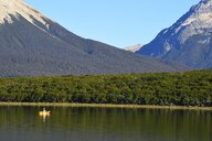 Man fishing from kayak at Tres Valles lake, Argentina - AURF08090