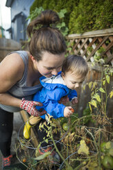 Mother with baby son in vegetable garden - AURF08141