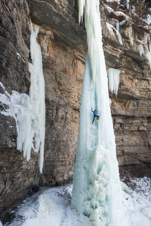 Climber ascending ice pinnacle, Vail, Colorado, USA - AURF08165