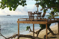 Chairs and table on a platform at a beach, Thulusdhoo, Male, Maldives - AURF08222