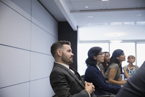 Businessman listening in conference room meeting - HEROF03635