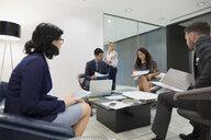 Business people meeting in office lobby - HEROF03659