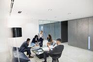Business people meeting in office lobby - HEROF03662