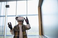 Boy using virtual reality simulator in science center - HEROF03854