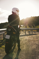 Italy, Elba Island, female motorcyclist at viewpoint - FBAF00228