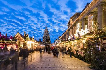 Germany, Baden-Württemberg, Stuttgart, Christmas market on castle square at night - WD04997