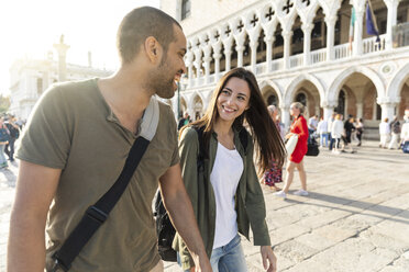 Italy, Venice, happy tourist couple enjoying the city at sunset - WPEF01252