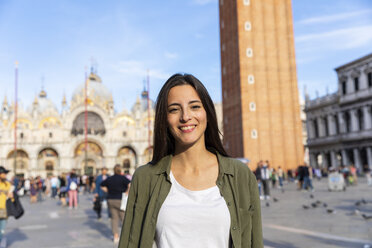 Italy, Venice, portrait of smiling young woman on St Mark's Square - WPEF01258