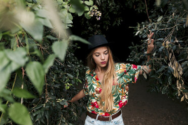 Blond young woman surrounded by leaves and nature - LOTF00027