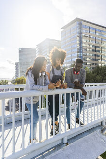 Friends standing on a bridge, - GIOF05342