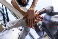 Friends stacking hands, view from below - GIOF05375