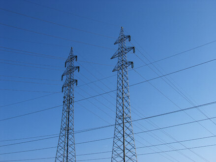 Power pylons under blue sky - WWF04759