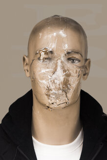 Damaged head of male display dummy glued with sellotape - SKAF00133