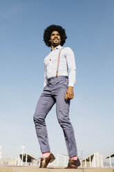 Stylish man standing against blue sky - JRFF02423