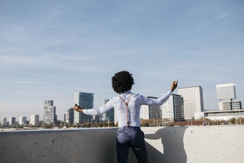 Spain, Barcelona, back view of dancing man - JRFF02432