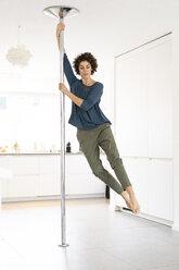 Woman doing pole dance at home - JOSF02675
