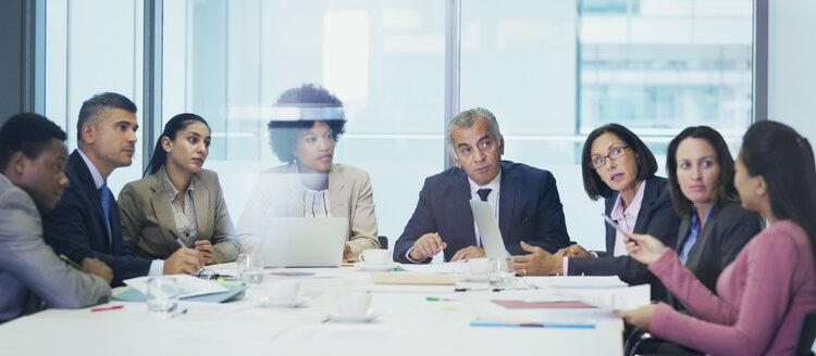 Business people talking in conference room meeting - HOXF04288