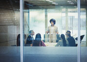 Businesswoman leading conference room meeting - HOXF04303