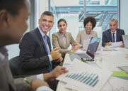 Smiling business people in conference room meeting - HOXF04309