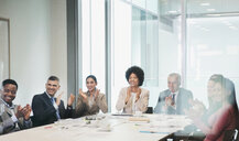 Happy, supportive business people clapping in conference room meeting - HOXF04321
