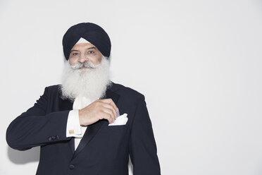 Portrait confident senior man with white beard wearing turban - CAIF22406