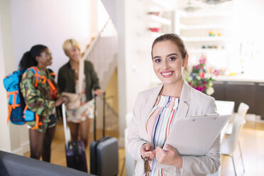 Portrait confident female real estate agent helping women arriving in house rental - CAIF22491