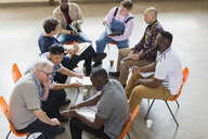 Men talking in group therapy - CAIF22506