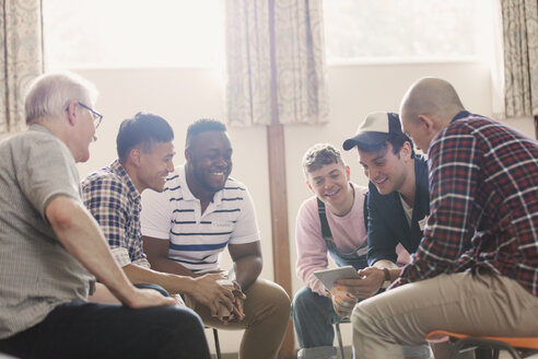 Men talking in group therapy - CAIF22518