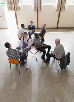 Men talking in group therapy - CAIF22527