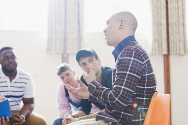 Men talking and listening in group therapy - CAIF22554