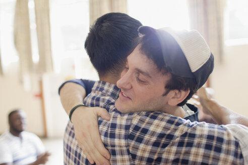 Men hugging - CAIF22563