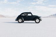Custom black Vintage VW Beetle parked on Salt Flats - MINF09998