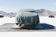 Race car covered with protective cloth in the Salt Flats - MINF10019