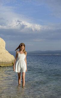 Croatia, Lokva Rogoznica, girl wading in water near seashore - BFRF01957
