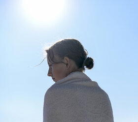 Profile of girl at backlight wrapped in a towel - BFRF01960