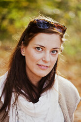 Portrait of beautiful young woman in forest - ASTF01350