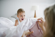 Happy toddler son playing with mother in bed at home - HAPF02817