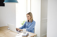Woman with laptop working at home - HAPF02856