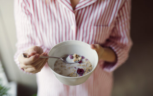 Close-up of woman holding cereal bowl - HAPF02865