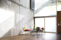 Sitting area in a loft at concrete wall - FKF03156