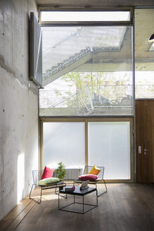 Sitting area in a loft at concrete wall - FKF03207