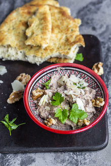 Bowl of homemade aubergine cream with walnuts, parmesan and parsley served with pita bread - SARF04046