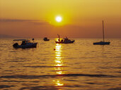 Croatia, Kvarner Gulf, Pag island, Novalja, fishing boats at sunset - WWF04804