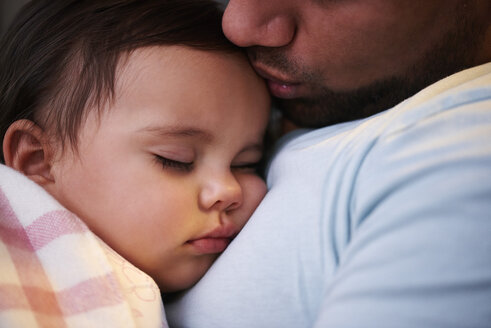 Close-up of father kissing sleeping baby girl - ABIF01109