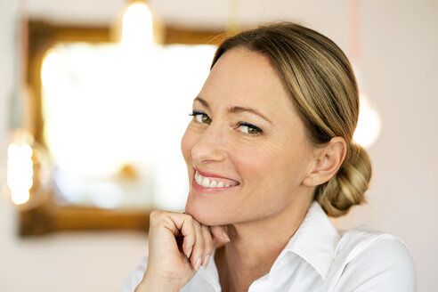 Portrait of smiling blond businesswoman - DMOF00090