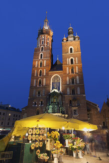 Poland, Krakow, Old Town, Saint Mary Church at night and flowers stand on the Main Square - ABOF00389