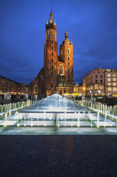 Poland, Krakow, Old Town at night, illuminated Saint Mary's Church and fountain - ABOF00392