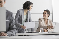 Businesswomen working at laptop in conference room - HEROF04162