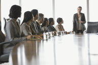 Businesswoman leading meeting in conference room - HEROF04168