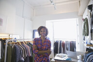 Portrait of confident business owner in clothing shop - HEROF04408